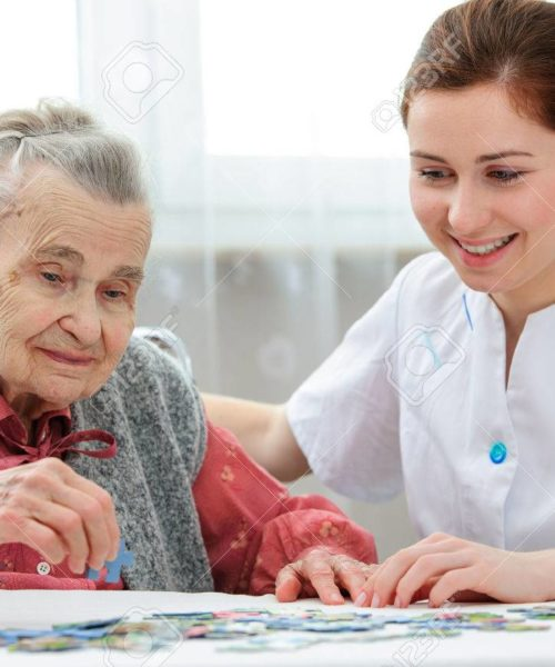 31191693-elder-care-nurse-playing-jigsaw-puzzle-with-senior-woman-in-nursing-home